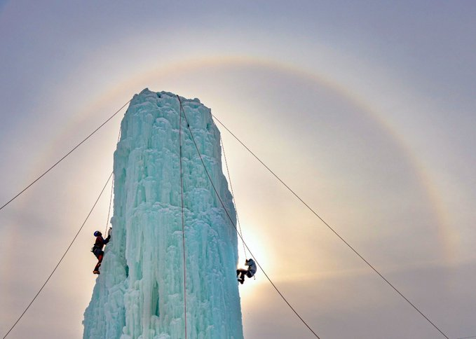 Name:  Ice Climbing with massive sunhalo in the background.jpeg